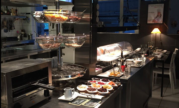 Breakfast buffet in the kitchen of Hotel B Design & Spa